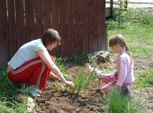 Volunteer planting with child